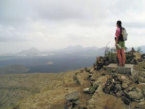 Standing on the volcanic crater rim of Caldera Blanca, Lanzarote.